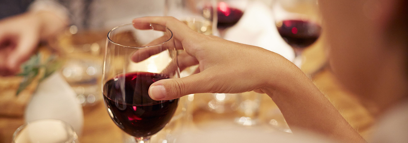 close-up-of-female-holding-glass-with-redwine-498071509-577d5a0b5f9b585875fa4840